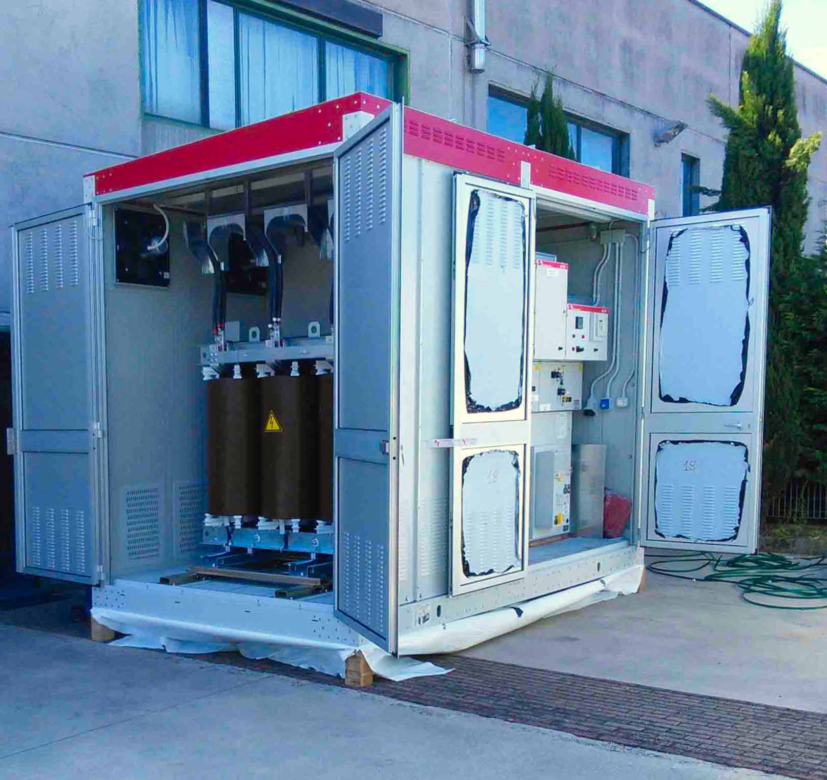 Modular compact substation with electrical panels